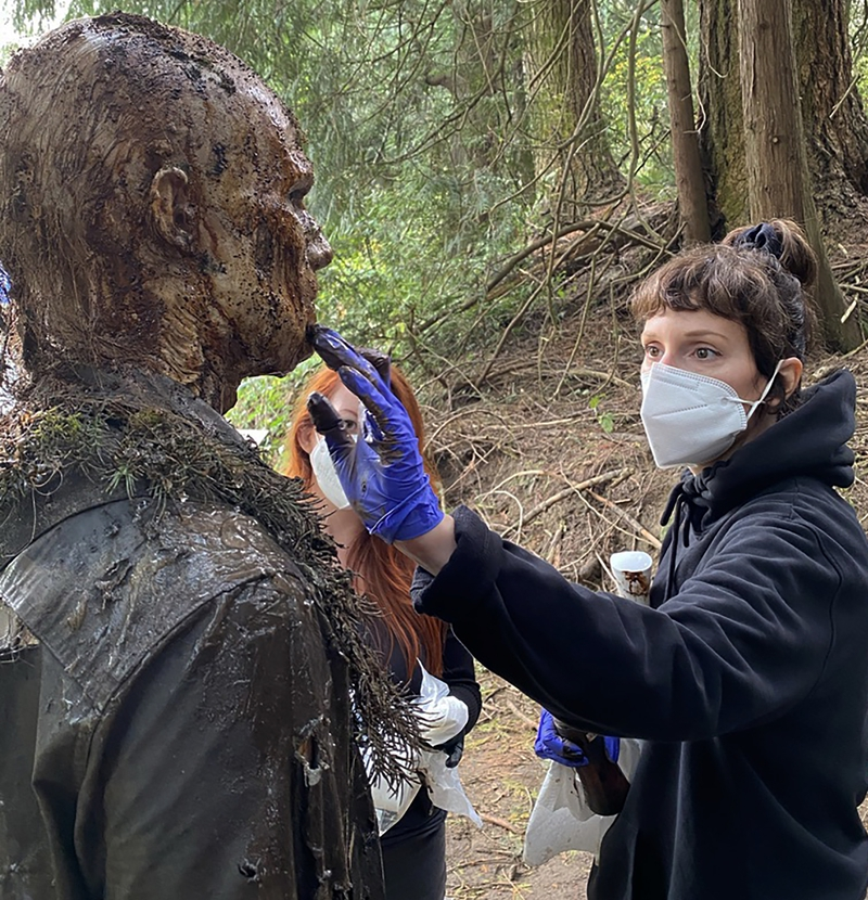 4 DAY OF THE DEAD MFX ARTIST JEN LATOUR TOUCHES UP A ZOMBIE.jpg